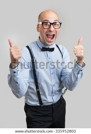 funny bald man wearing bow tie and suspenders showing thumbs up