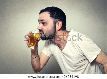 funny bearded man drinking beer