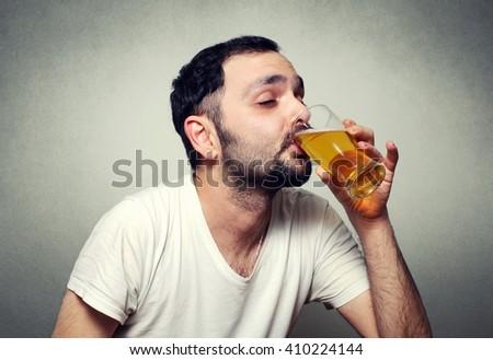funny bearded man drinking beer - stock photo