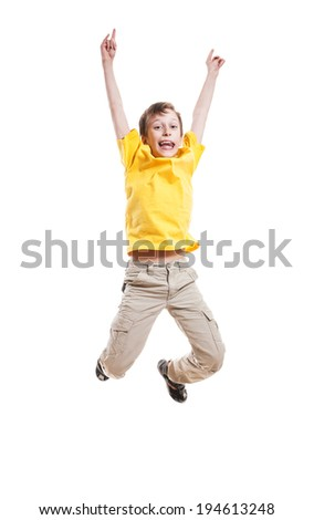 Funny beautiful child in yellow t-shirt jumping and laughing over white background