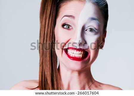 Funny, beautiful girl showing teeth.