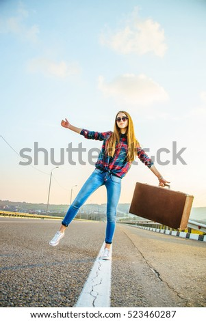 Funny beautiful girl traveler. The image with sunlight effect.