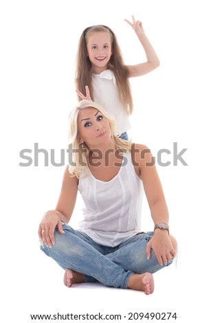 funny beautiful mother and daughter isolated on white background
