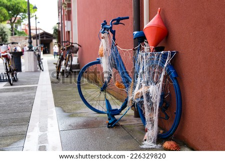 Funny bicycle with fishing nets shot in Caorle town, Italy - stock photo