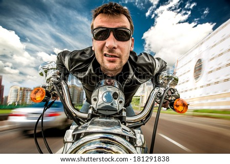 Funny Biker in sunglasses and leather jacket racing on the road (fisheye lens) - stock photo