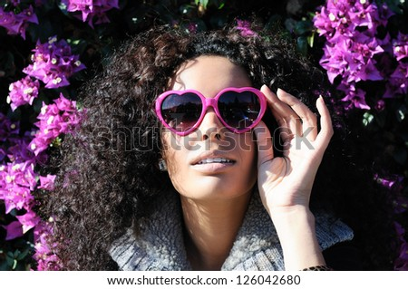 Funny black girl with purple heart glasses - stock photo