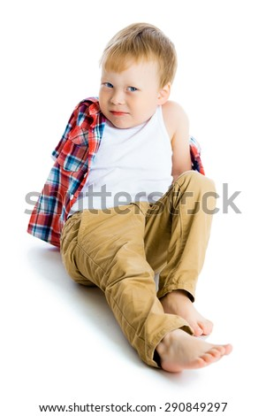 Funny blue-eyed three-year boy on a white background. Studio photo