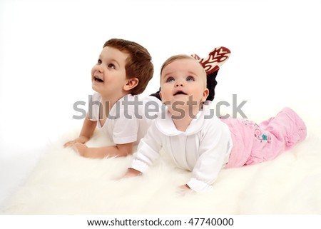 funny boy and a girl lying on the floor - stock photo