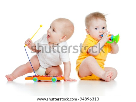 Funny boy baby  with musical toys. Isolated on white background - stock photo