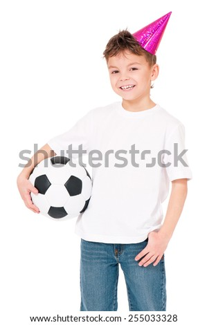 Funny boy in birthday cap with soccer ball, isolated on white background - stock photo