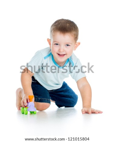 funny boy kid playing with toy - stock photo