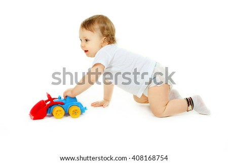 Funny boy kid playing with toy