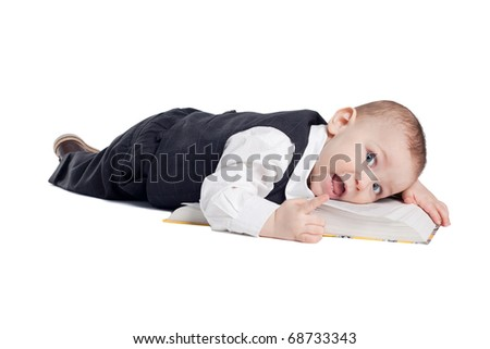 funny boy lying on the book