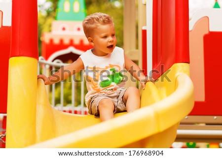 funny boy on playground - stock photo