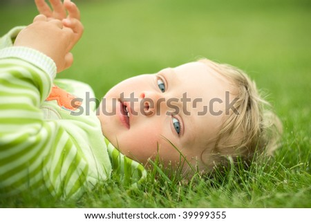 funny boy on the grass