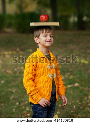 funny boy with book on his head - stock photo