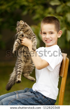 funny boy with cat - stock photo