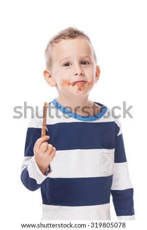 Funny boy with empty ice-cream stick on isolated white
