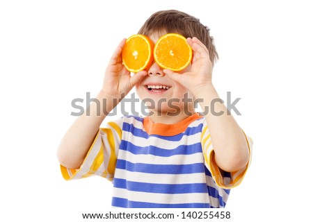 Funny boy with fruits on eyes, isolated on white - stock photo