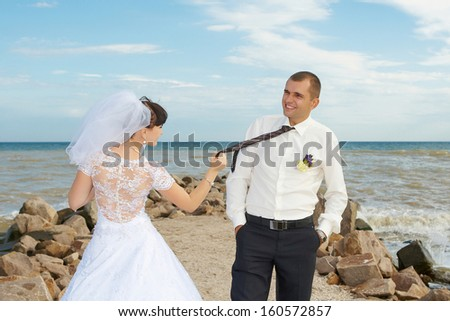 funny bride and groom blue background laughing and having fun