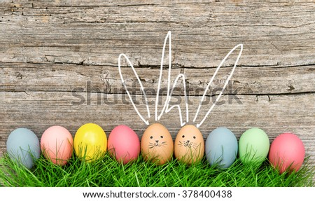 Funny bunnies easter eggs. Cute holidays decoration - stock photo