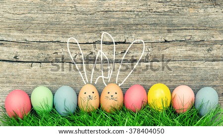 Funny bunnies easter eggs. Cute holidays decoration. Vintage style - stock photo