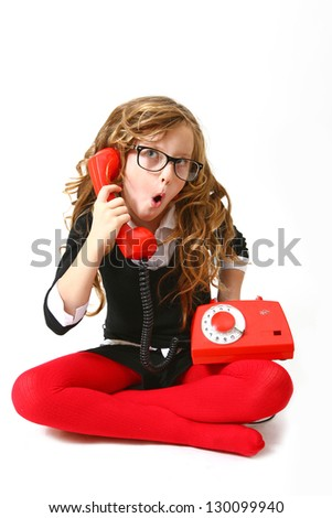 Funny business girl with phone and glasses on a white background sitting - stock photo