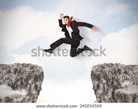 Funny business man jumping over rocks with gap concept