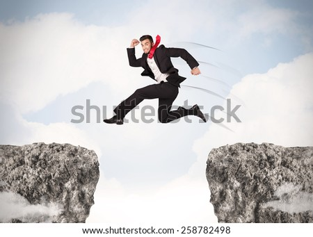 Funny business man jumping over rocks with gap concept - stock photo