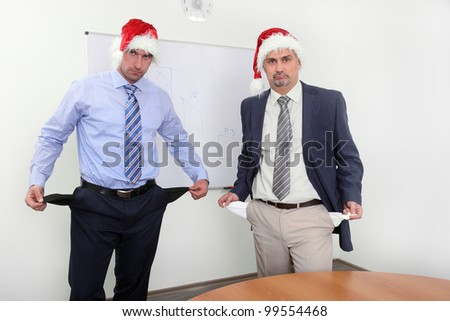 funny business men with empty pockets - stock photo