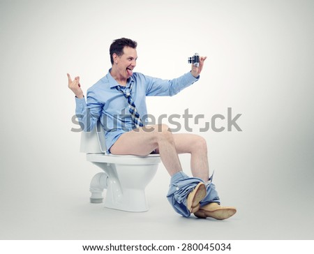 Funny businessman photographing himself in the toilet on white background. Selfie everywhere concept - stock photo