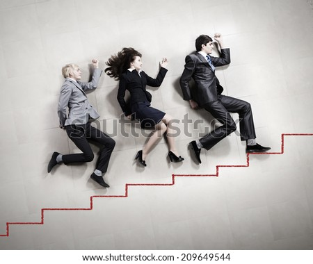 Funny businesspeople lying on floor and acting like running - stock photo