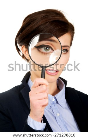 Funny businesswoman with magnyfing glass. - stock photo