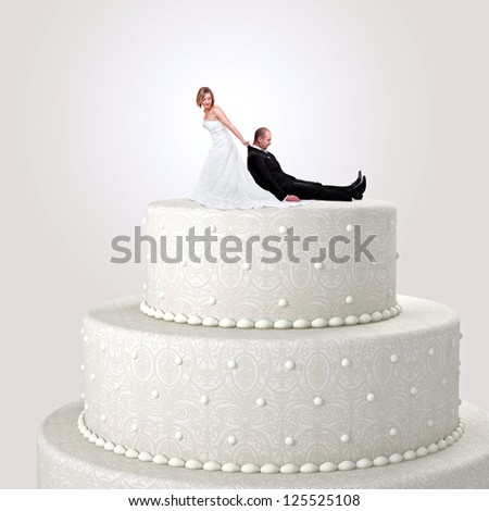 funny cake topper with bride and groom - stock photo