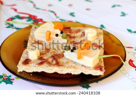 Funny canapes for kids on a Christmas table. Cute cheese mice cheese for children. - stock photo