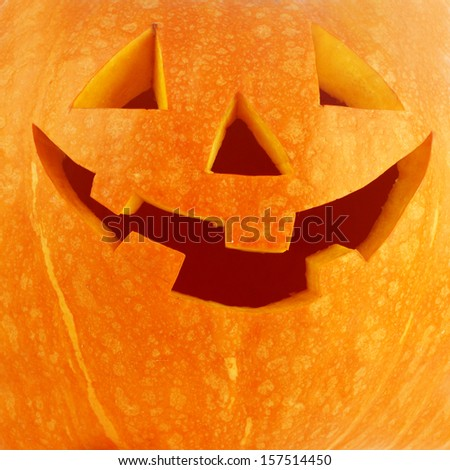 Funny carved Halloween pumpkin background close-up