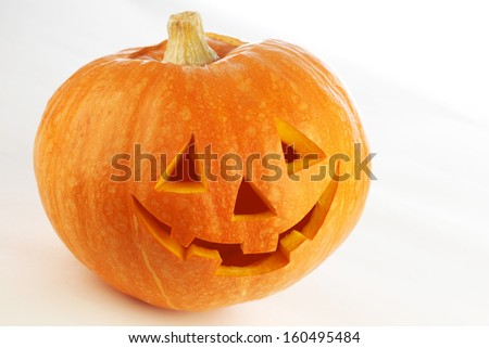 Funny carved Halloween pumpkin on white background - stock photo
