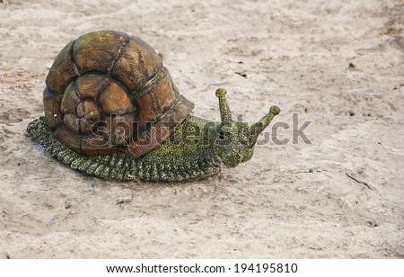 Funny ceramic snail attached to the  house wall. Architectural detail of typical house in Provence (France). - stock photo