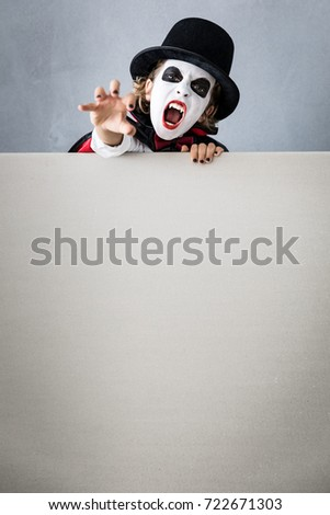 Funny child dressed scary Halloween costume. Kid painted terrible v&ire holding banner blank. Autumn  sc 1 st  Shutterstock & Funny Child Dressed Scary Halloween Costume Stock Photo u0026 Image ...