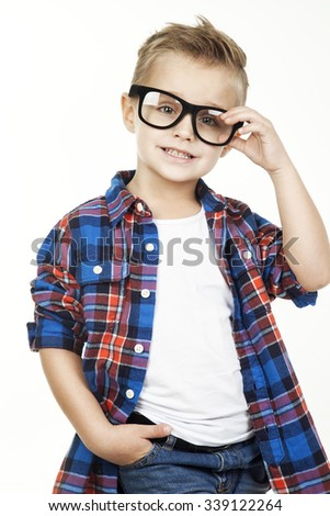 Funny child.fashionable little boy in glasses, jeans, white t-shirt and plaid shirt.stylish kid in sport shoes. fashion children