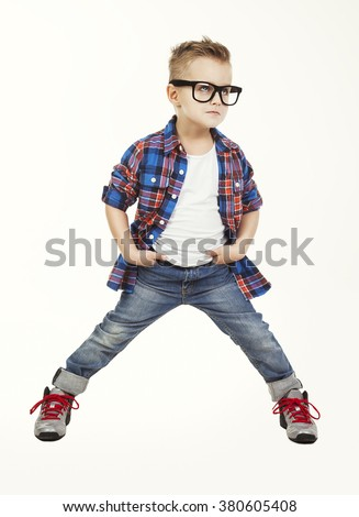 Funny child.fashionable little boy in glasses, jeans, white t-shirt and plaid shirt.stylish kid in sport shoes. fashion children - stock photo