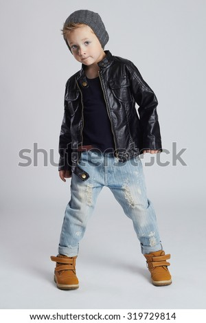 Funny child.fashionable little boy in hat.stylish kid in yellow shoes.winter fashion children - stock photo