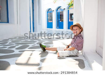 Funny child. Fashionable little boy in sunglasses and hat.  Santorini Park - stock photo