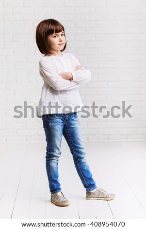 Funny child girl isolated on gray background - stock photo