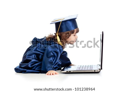 funny child in academician clothes  using laptop - stock photo