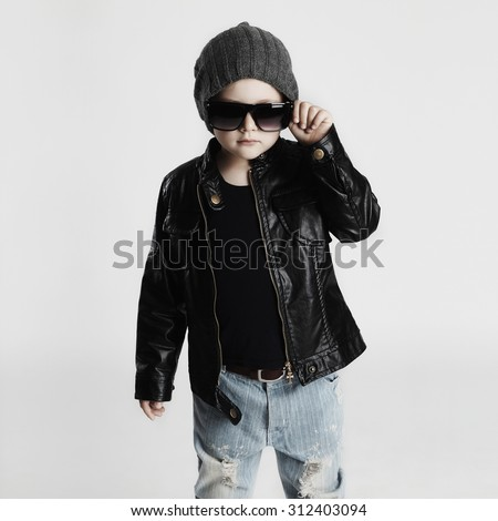 Funny child in hat.fashionable little boy in sunglasses.stylish kid in leather. fashion children - stock photo