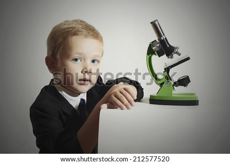 funny child.little scientist.fashion portrait of little boy in tie.Schoolboy working with a microscope.Smart kid.Education - stock photo