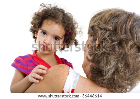 Funny child playing with a senior . - stock photo