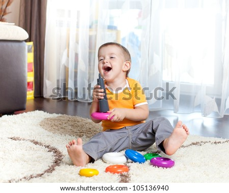funny child playing with toy indoor