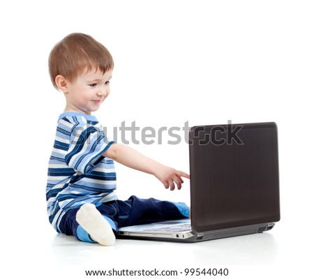 Funny child using a laptop over white background - stock photo
